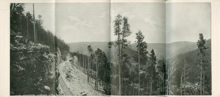 "Photo ""Approaching Spearfish Canyon"" showing railway along mountain slope"