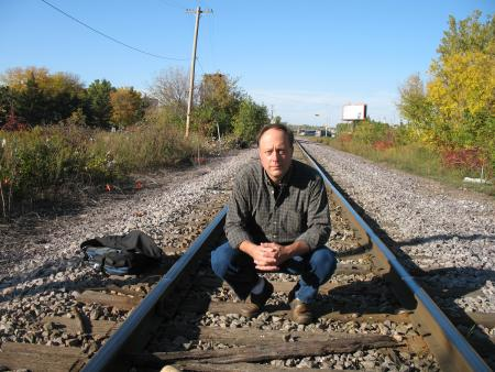Photo of Eric Olmanson on railway tracks