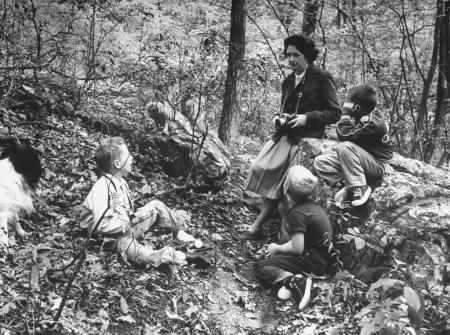 Photo of Rachel Carson talking with children in the woods