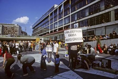 An environmentalist group demonstrates outside the New Parliament building during one of the conference sessions.