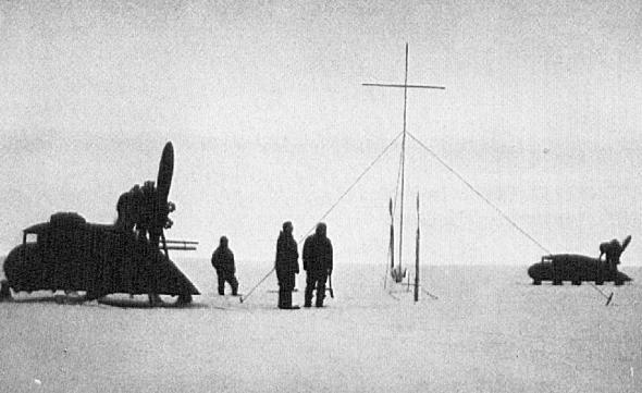 Propeller sleds and expedition members at the grave of Alfred Wegener